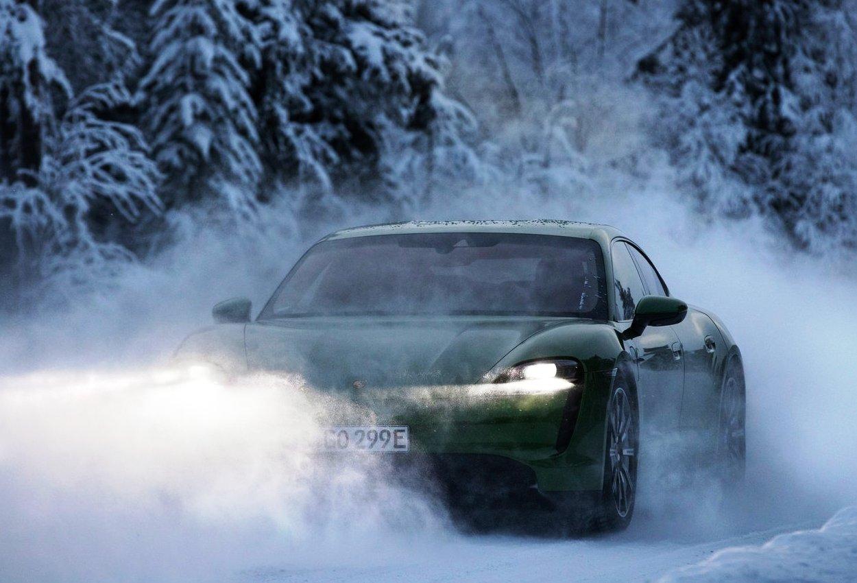 Porsche Taycan 4S driving in snow