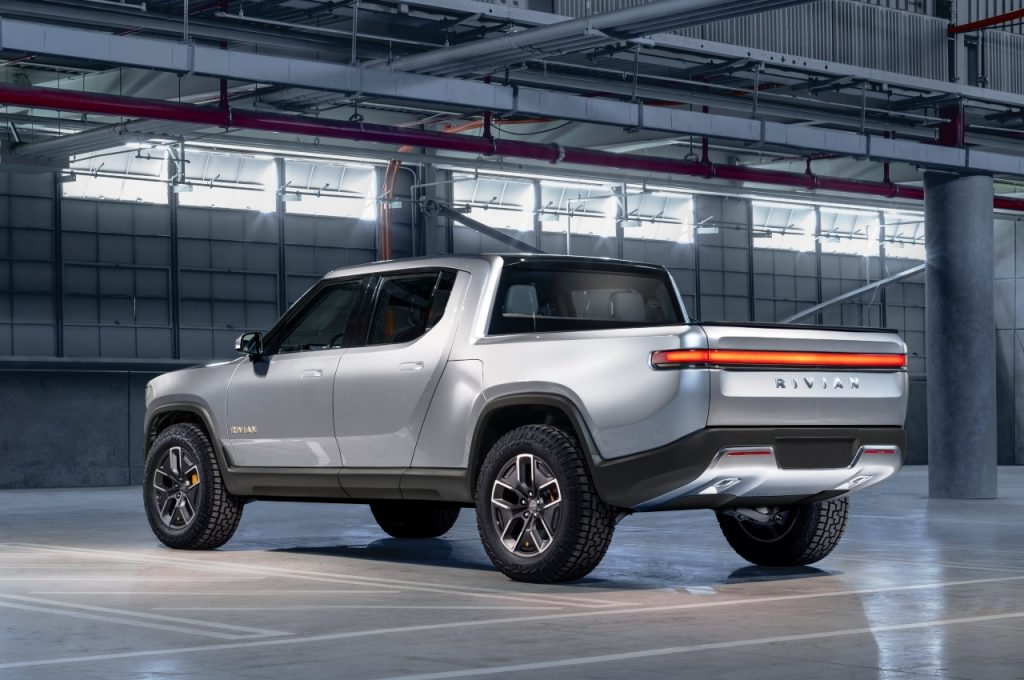 Rivian R1T electric pickup truck rear three quarter view