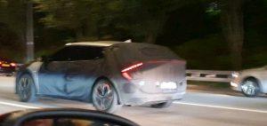 Kia CV electric car rear quarters spy shot E-GMP