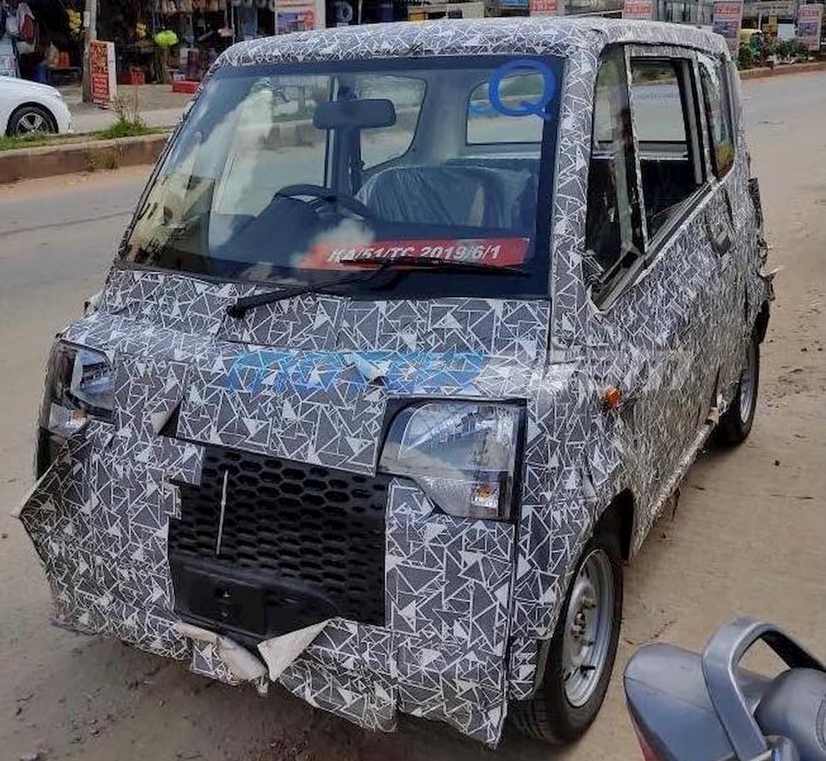 Production Mahindra Atom front quarters