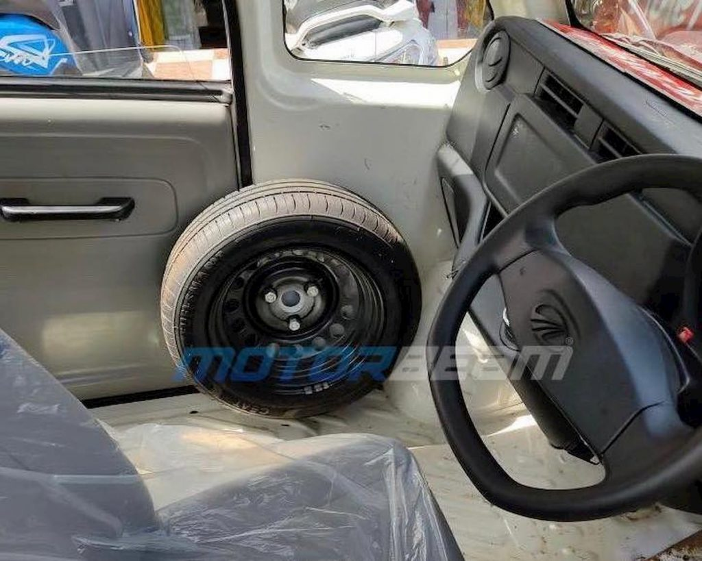 Production Mahindra Atom interior spare wheel