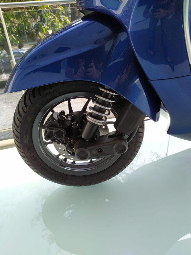 Bajaj Chetak electric scooter red front disc brake