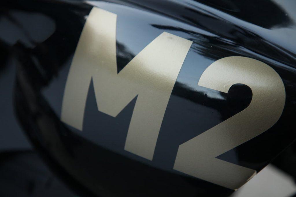 M2 electric bike M2 logo